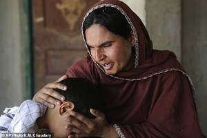 Baby Small Girl Forced Sex - Kausar Parveen comforts her child who was allegedly raped by a mullah or  religious cleric,