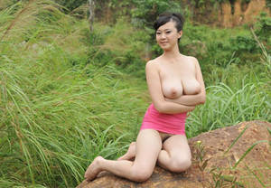 hairy babes with big tits - Chinese babe with big boobs and a hairy pussy gets naked in the countryside.