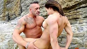 muscular tranny fucking female - Body builder and a fit girl have athletic sex on the beach