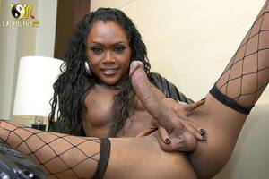black tranny with dildo - Black shemale with huge cock dildos her ass wearing fishnet stockings and  black boots