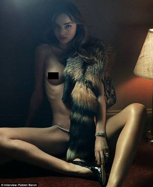 Angel Miranda Kerr Porn - Raunchy: Miranda Kerr posed in nothing put a fur scarf, a designer handbag  and