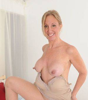 mature hard tits - Lovely mature with erected nipples