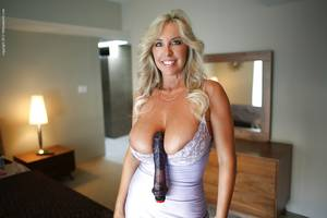 big black dildo - ... Lustful mature bombshell with huge melons playing with a big black dildo  ...
