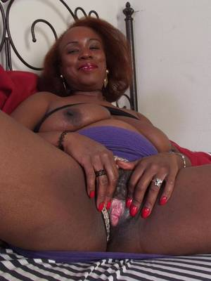 ebony mature pink pussy - Mature black woman shamelessly spreads her pussy lips and shows her pink  vagina