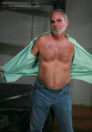 Belly Hair Gay Porn - Aged silver hair gay man with a beard and hairy chest strips nude and gets  his dick licked