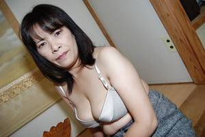 asian big boob hardcore porn - ... Asian milf Yumiko undressing her big boobs and hairy pussy ...