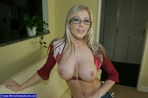 Michelle Barrett Porn - Four-eyed Michelle Barrett in top and mini skirt opens her long legs and  shows her big melons