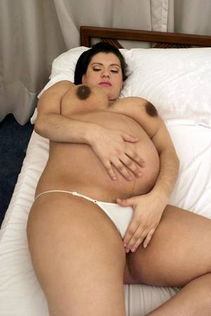 latina pregnant dildo - ... Naughty pregnant Latina playing with her huge titties and belly while  shoving a dildo into her ...