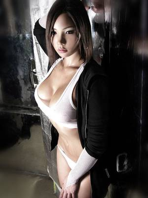 Most Beautiful Asian Women In Porn - Enjoy this photo of a stunning asian girl wearing a tiny white tank top and  no bra