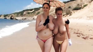 huge boobs beach sex - British babes with big natural boobs walk topless at the beach